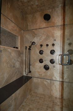 Luxurious showers are trending for 2016.  A few bells and whistles include benches, body sprays, multiple shower heads and the capability to generate steam.