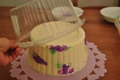 making a giant cupcake cake wrapper with a take out container... tell me this isn't ingenious!!! :)