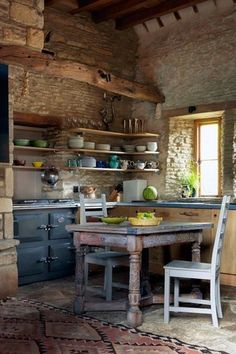 Rustic Stone Kitchen with Open Shelves and Vintage Stove