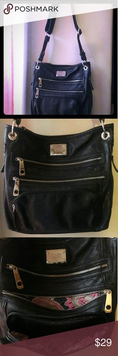 TYLER RODAN Black Bag. Super cute adjustable black purse by TYLER RODAN.   3 pockets in front...2 on the side...1 on the back...loads of pockets inside.   Great foe traveling.    Can wear on shoulder or across.  New without tags..never used. Tyler Rodan Bags Crossbody Bags