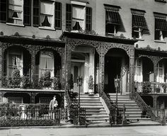 Gramercy Park, nos. 3-5, Manhattan.    Notes: Code: I.A.2. Man leaving gate of 5 Gramercy Park, decorative ironwork adorns houses, which also have iron lamps at base of stairs.    Source: Changing New York / Berenice Abbott. (more info)    Repository: The New York Public Library. Photography Collection, Miriam and Ira D. Wallach Division of Art, Prints and Photographs.