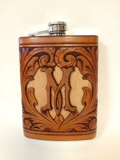 Beautifully carved & tooled leather cover on a flask.