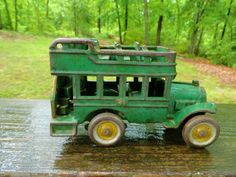 1930s green double decker toy bus.
