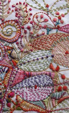 Intricate embroidery by Carla Madrigal of San Francisco; embroidered over screen printed organic fabric by Umbrella Prints, Australia