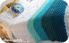 The Douangphilas: Ombre Crochet Throw - Crocodile stitch Bottom Row: Peacock by I Love This Yarn from Hobby Lobby, next; Michaels Aqua Impeccable, next, Turquoise HL I Love This Yarn, and finally Lion Brand Pound of Love in Pastel Green.
