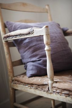 rustic chair with lavender pillow