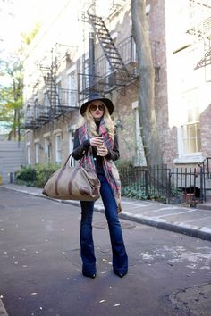 boot cut jeans with casual top and blanket scarf