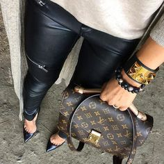 Leather pants with a timeless Louis Vuitton piece.