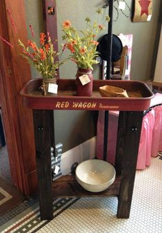 Lil red wagon idea --- take the wheels off and use the top for a table, then attach the wheels as casters.