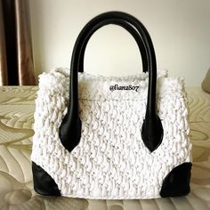 Tyarn crocheted bag with genuine leather handle