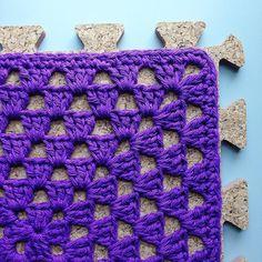 Two done, two more to do. #crochet #hooker #cotton #sugarncream #grannysquare #corkboard #purple