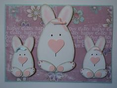 handmade Easter card /// The Eggs and Ovals Family Card by candee porter ... adorable punch art bunnies with egg-shaped bodes and pink heart noses ... luv them!!