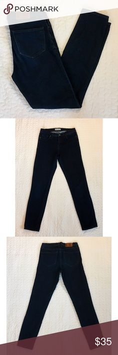 """Madewell """"Skinny Skinny"""" jeans in dark indigo Dark indigo wash with a hint of stretch and black hardware. Size 28 with 8.5"""" rise and 29"""" inseam. 89% cotton, 10% polyester, and 1% spandex. Excellent used condition. Madewell Jeans Skinny"""