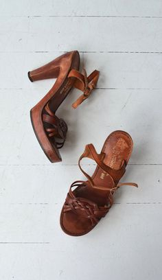 Vintage 1970s shoes with braided leather, open toe, ankle strap, tall wooden heel, wooden ball platform and rubber treaded sole. ✂-----Measurements  fits like: us 6.5 | euro 37 | uk 4 insole: 9.5 ball: 3 heel: 4 with 1 ball platform brand/maker: Thom McAn condition: excellent  ➸ more vintage footwear http://www.etsy.com/shop/DearGolden?section_id=5800174  ➸ visit the shop http://www.DearGolden.etsy.com _____________________  ➸ blog | www.deargolden.com ➸ twitter | deargolden ➸ facebook.com…