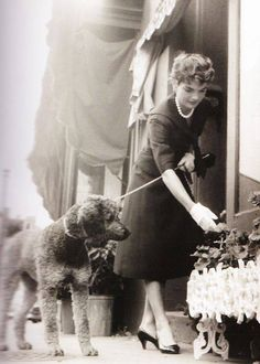 Jacqueline Bouvier Kennedy Onassis with her Poodle friend in France… also was a 1st Lady…