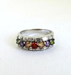 Great Gift Idea! Vintage Sterling Silver Multistone CZ Band Ring.  CZs in Purple, Orange-Yellow, Red and Green front the wide…
