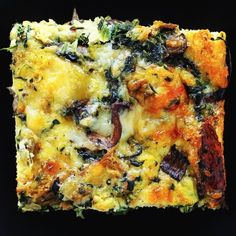 Spinach, Mushroom and Gruyere Strata-this layered casserole made with cubed bread, eggs, veggies and cheese is the perfect brunch dish!