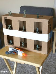 Nerf Gun Game: Army Guy Shootout Turn a cardboard box into an army guy shooting gallery for Nerf guns! Plastic army guys are a great target to shoot. They're fun to knock over, and the price is definitely right! In general, we prefer to use Nerf targets Projects For Kids, Diy For Kids, Crafts For Kids, Guy Crafts, Toddler Activities, Fun Activities, Babysitting Activities For Boys Indoor Games, Army Games For Kids, Kids Party Games Indoor
