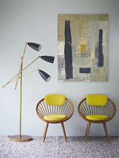 combination of grey and yellow leaves me breathless. and the furniture...