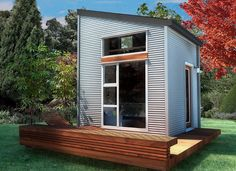 """NOMAD Micro Home: Ultra modern, sustainable tiny house kit, 10X10, off grid-capable. Once the kit is flat packed and shipped to the buyer it can be assembled by 2 people with an electric drill and """"handyman"""" level carpentry skills. Under 30K with off-grid solar, water treatment and rainwater collection packages available. #tinyhouse #sustainabletinyhouse #sustainableprefab"""