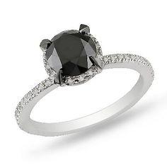 ooh! 2 CT. black + white diamond solitaire ring