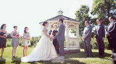 Rustic outdoor wedding ceremony in front of the gazebo behind Smith Barn in Peabody, MA...