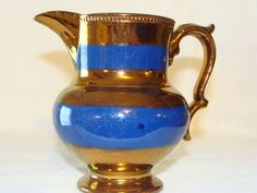 Double blue, unembellished bands on this copper lustre pitcher. Luster, Tea Set, Porcelain, Copper, Antiques, Blue, Yellow, Silver, Bristol