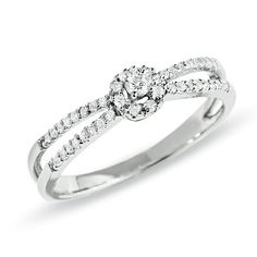 1/6 CT. T.W. Diamond Split Shank Ring in 10K White Gold. Cheap enough so I won't feel guilty - $199.00!