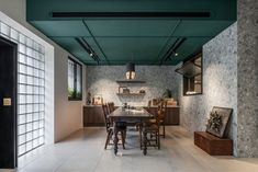 Photography studio located in Hsinchu city, Taiwan, redesigned by Han Yue Interior Design. Eco Deco, Glass Blocks Wall, Glass Brick, Colored Ceiling, Ceiling Color, Studios Architecture, Wooden Front Doors, Black And White Marble, Brickwork