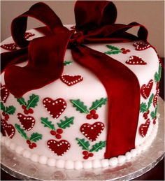 Christmas Fruit Cake, decorated with sugar-paste hearts and holly . and 'wrapped' with a red silk ribbon Christmas Cake Designs, Christmas Cake Decorations, Christmas Cupcakes, Christmas Sweets, Holiday Cakes, Christmas Cooking, Noel Christmas, Christmas Goodies, Fondant Christmas Cake