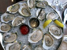 Raw Oysters. My recipe calls for a splash of hot sauce, a squeeze of lemon, a shake of pepper and shoot.  And you can put them on a cracker too.