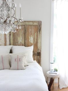 love whites & distressed/old wood.... Oh and the chandelier is the bomb!