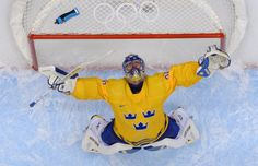 Sweden's goalkeeper Henrik Lundqvist celebrates as they are headed to the gold medal game in Sochi.