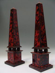 A Pair of Ebonized Wood with Veneered Red Tortoiseshell Obelisks.