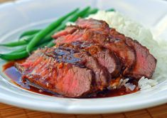 TESTED & PERFECTED RECIPE – Tender flat iron steak broiled and topped with a rich Asian-style brown sauce.