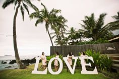 LOVE wedding sign + bridesmaids - Anna Kim Photography
