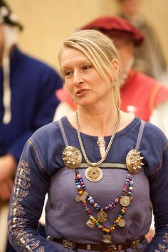 This is a photo of Reginleif. Here are a few educational links to the primary research, inspired by this image: http://urd.priv.no/viking/smokkr.html, http://www.darkcompany.ca/beads/beads.php, http://www.medieval-baltic.us/vikbuckle.html,http://medieval-baltic.us/bau-loops.pdf