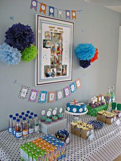 first birthday dessert  table pom poms garlands photo centerpiece cake cupcakes