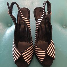 Cami Black & White Stripped  Sling Back Heel The slingback is not floppy.  Peep Toe. Black & white stripe.  Size 6.5.  Hardly worn. Cami Shoes Sandals