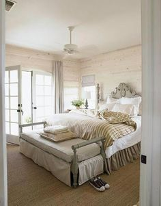 "White & Sage Bedroom  ""The master bedroom has a wild sage color on the painted bench and again on the bed,"" designer Ginger Barber says. ""I love it against crisp white linen and whitewashed walls."""