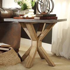 Complement your rustic, contemporary or industrial decor with this SIGNAL HILLS Aberdeen end table. With its X-shaped trestle design and rough-hewn, weathered oak base, the table adds plenty of aesthe
