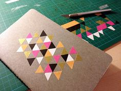 what's on my craft table?   my new notebook with washi tape triangles   momentstolivefor.com #Moleskine #washi tape #triangle