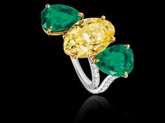 Sabbadini ~ Fancy vivid yellow oval diamond ring with pear-shaped emeralds from the High Jewellery collection