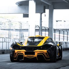McLaren P1 painted in Black w/ MSO Volcano Yellow accents all over the car Photo taken by: @mhjqm on Instagram