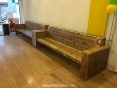 These large wooden pallet couches are made especially for some commercial purposes. We made these wooden pallet couches for a café that is owned by a friend of mine. And this long area is the waiting area where the customers wait for their parcels. A lot of people can be seated on the couches at the same time.