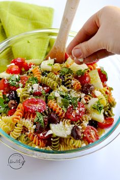 Greek pasta salad is a tangy and fresh dish that is perfect for a picnic or potluck.   APinchOfHealthy.com