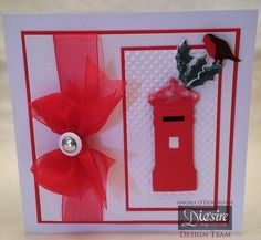 Angela O'Donoghue - Die'sire Christmas Classiques Postbox and Robin, Holly White and Red card - Red ribbon - Button and sparkle - #crafterscompanion #Christmas