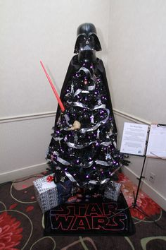Darth Vader complete with light saber.The purple and white led lights gave it a glow. Included a Star Wars fleece throw, and Yoda, lights. Donated and decorated by Dave Eyrise Athletes on the Move/ Realty Executives Integrity Leukemia And Lymphoma Society, C3po And R2d2, Star Wars Christmas, Light Saber, White Led Lights, Fleece Throw, How To Raise Money, Integrity, Athletes