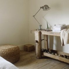 19th-century French workbench in a modern bedroom - nice!