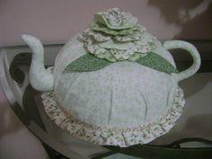 cobre bolo em tecido de algodão 100% com flores em alto relevo  pode retirar para lavar  Um lindo presente para sua cozinha  temos varias estampas